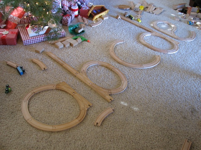 Practicing Letter Formation With Toy Trains